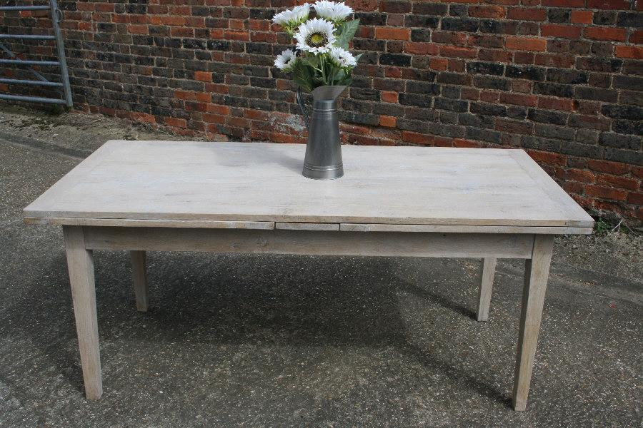 A most unusual bleached oak double drawerleaf table for Unusual extending dining tables