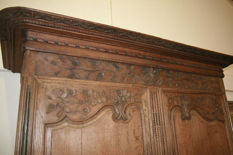 A beautiful chic carved French armoire