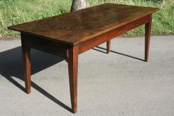 A dark rustic cherry antique table