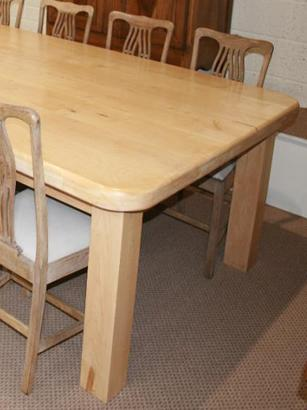 A fantastically large pale Maple Dining table