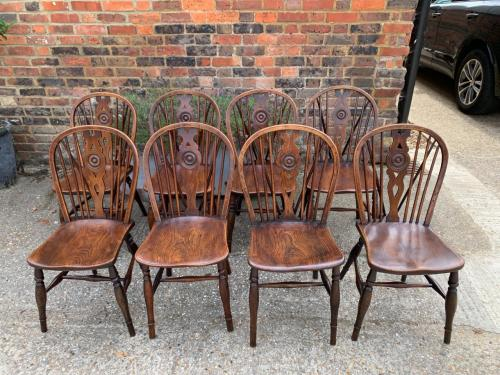 A Harlequin Set Of 8 Single Draught Back Chairs
