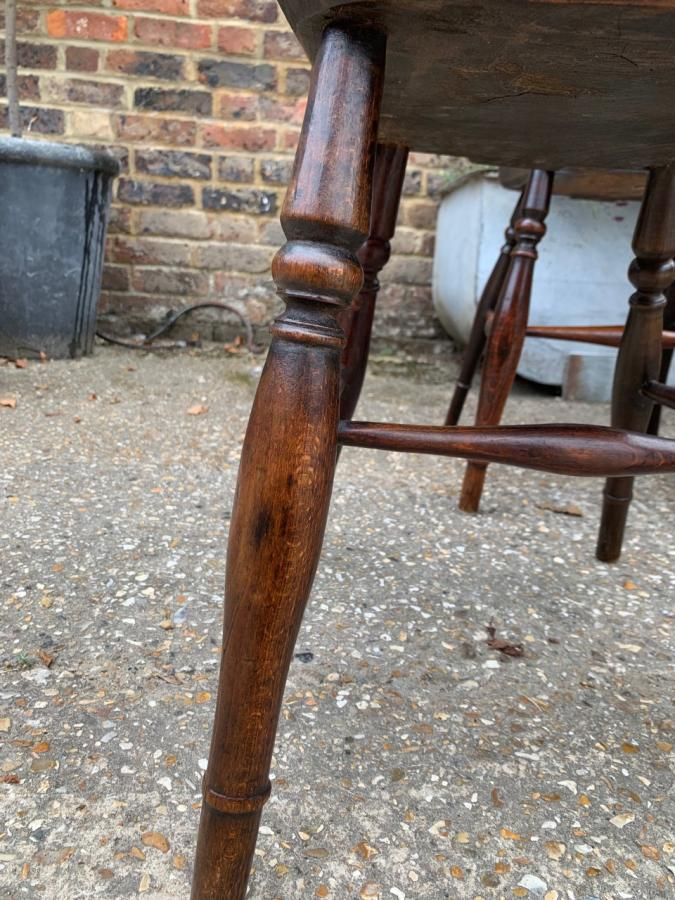 A matched set of 8 Windsor Wheelback Antique chairs