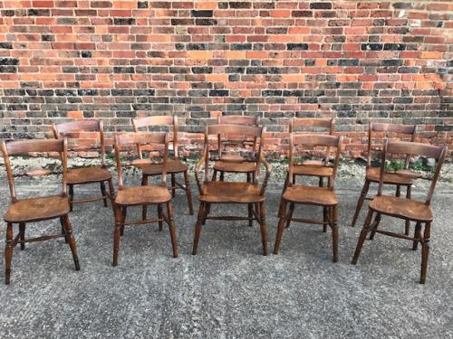 A matched set of nine plus one beechwood and elm Windsor chairs, Oxford mid 19th century