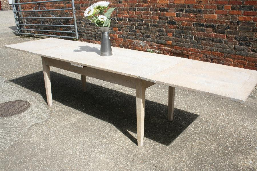 A most unusual bleached oak double drawerleaf table