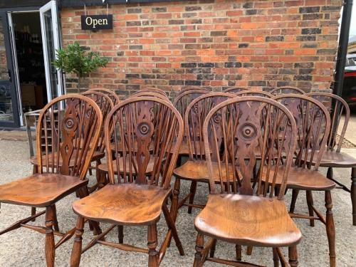 A Rare Matched Set of 16 Windsor Draught back Chairs