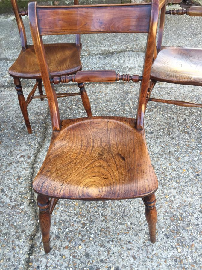 A set of 8 Oxford scroll back chairs