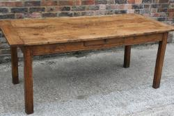 An 18th Century fruitwood farmhouse table