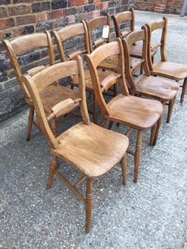 Eight pale Oxford scroll back chairs